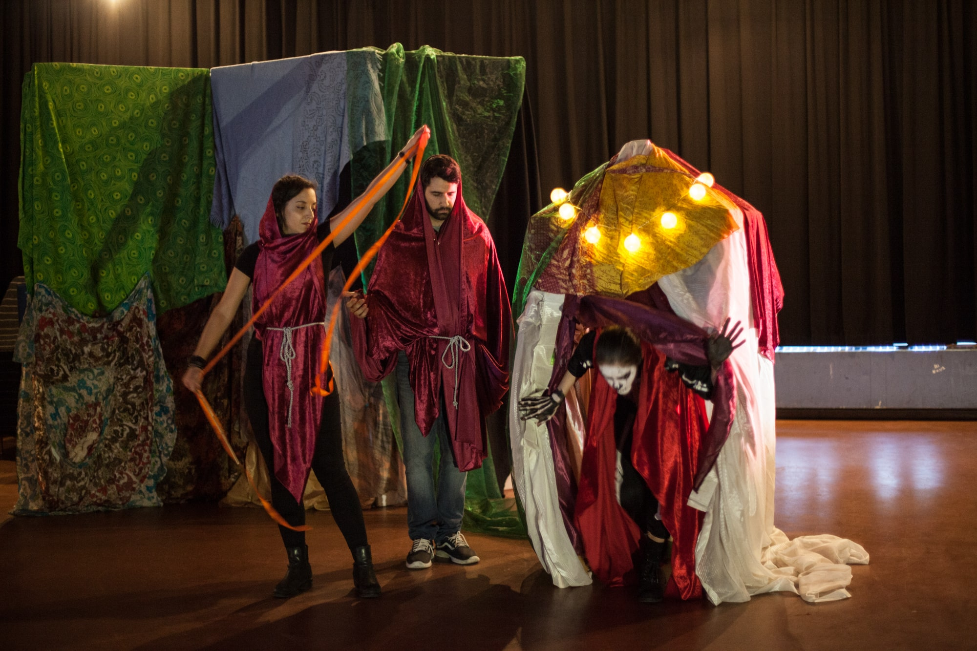 Act Attack theatre class people in costumes performing