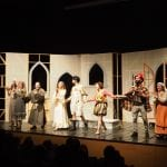 Theatre performance, the actors are ready to bow, some of them clap