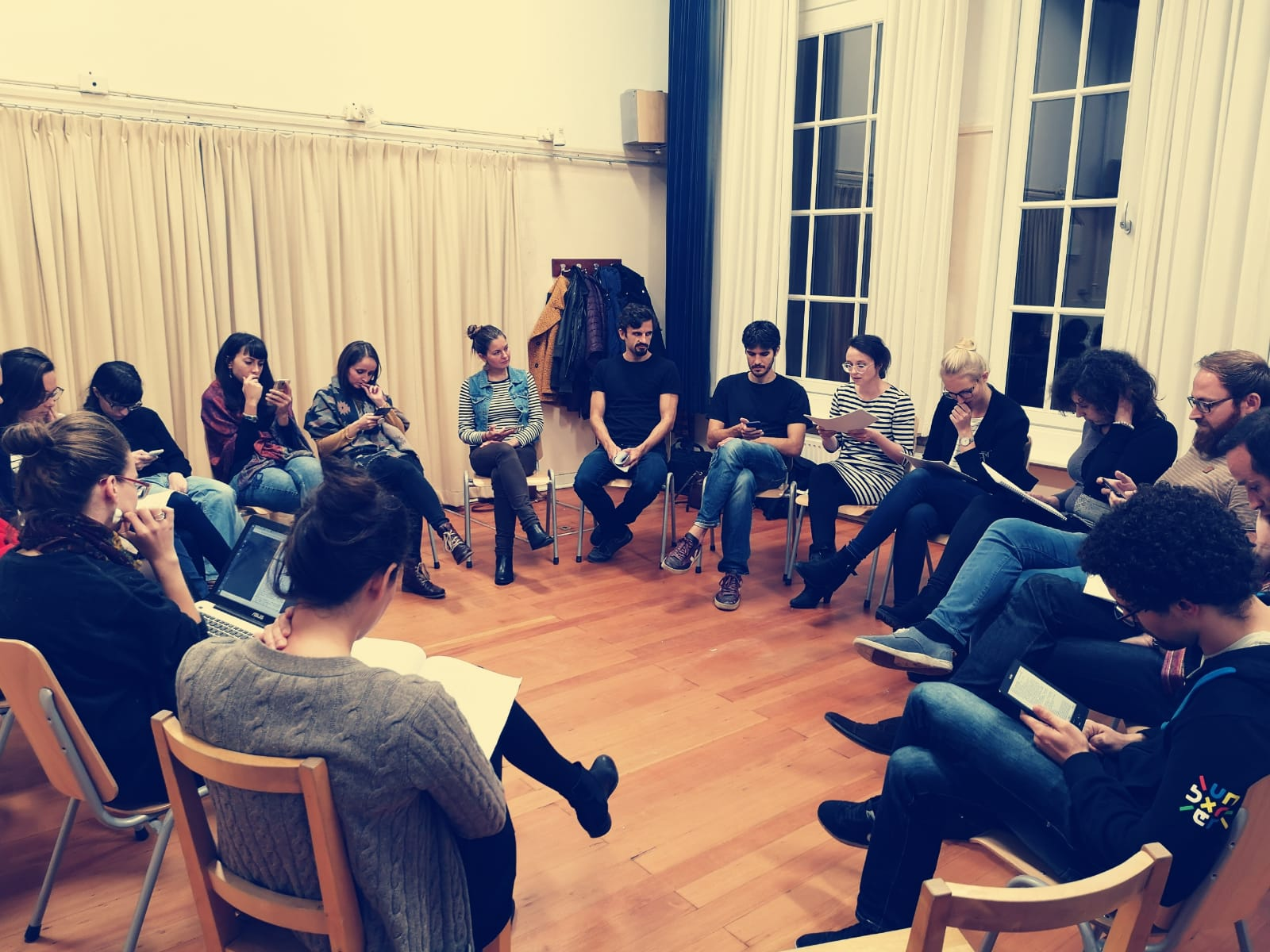 Acting Class Beginners, group of people is sitting on chars in a circle