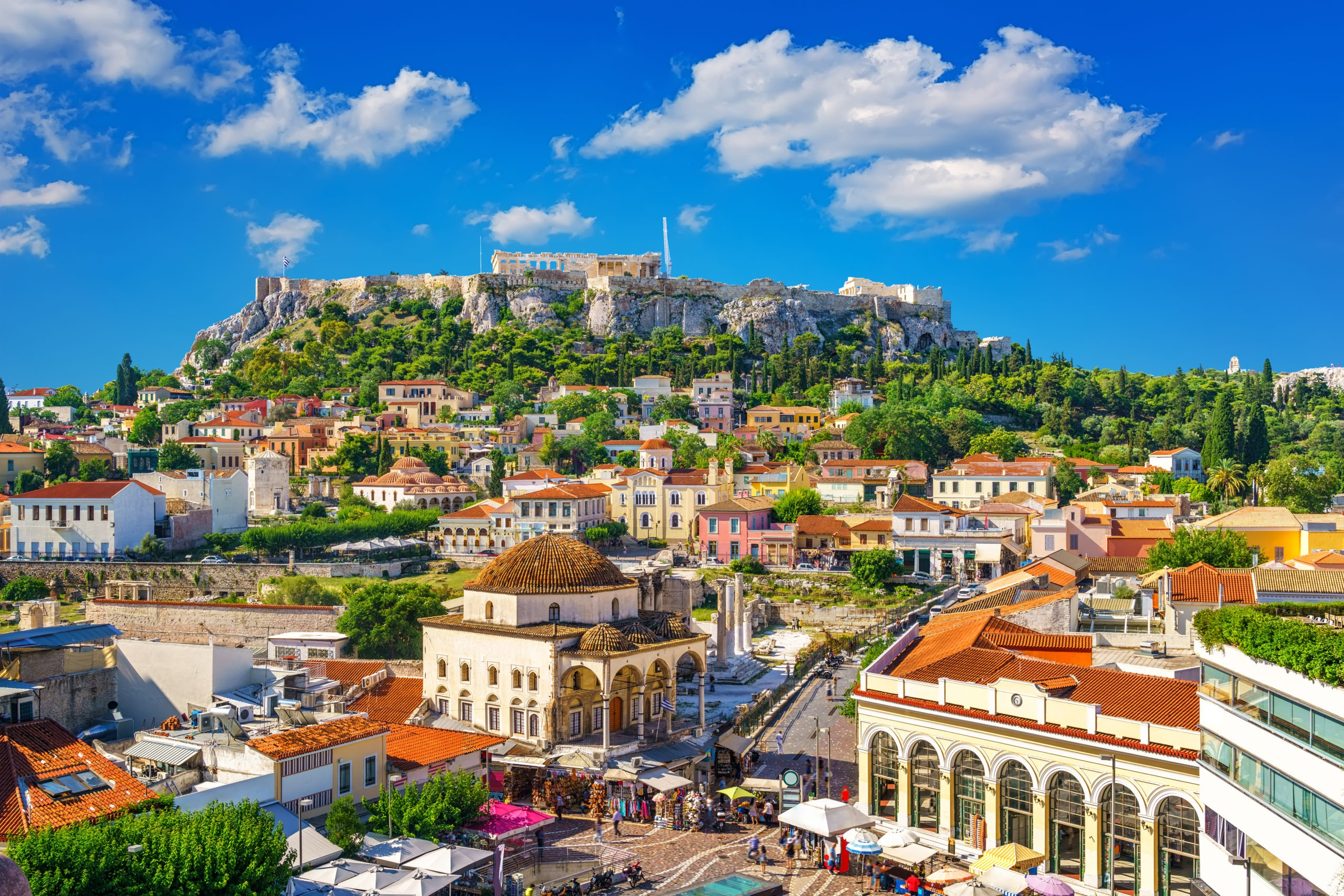 View of the ancient Acropolis hill, as seen from the oldest district of Athens, Plaka. Country: Greece