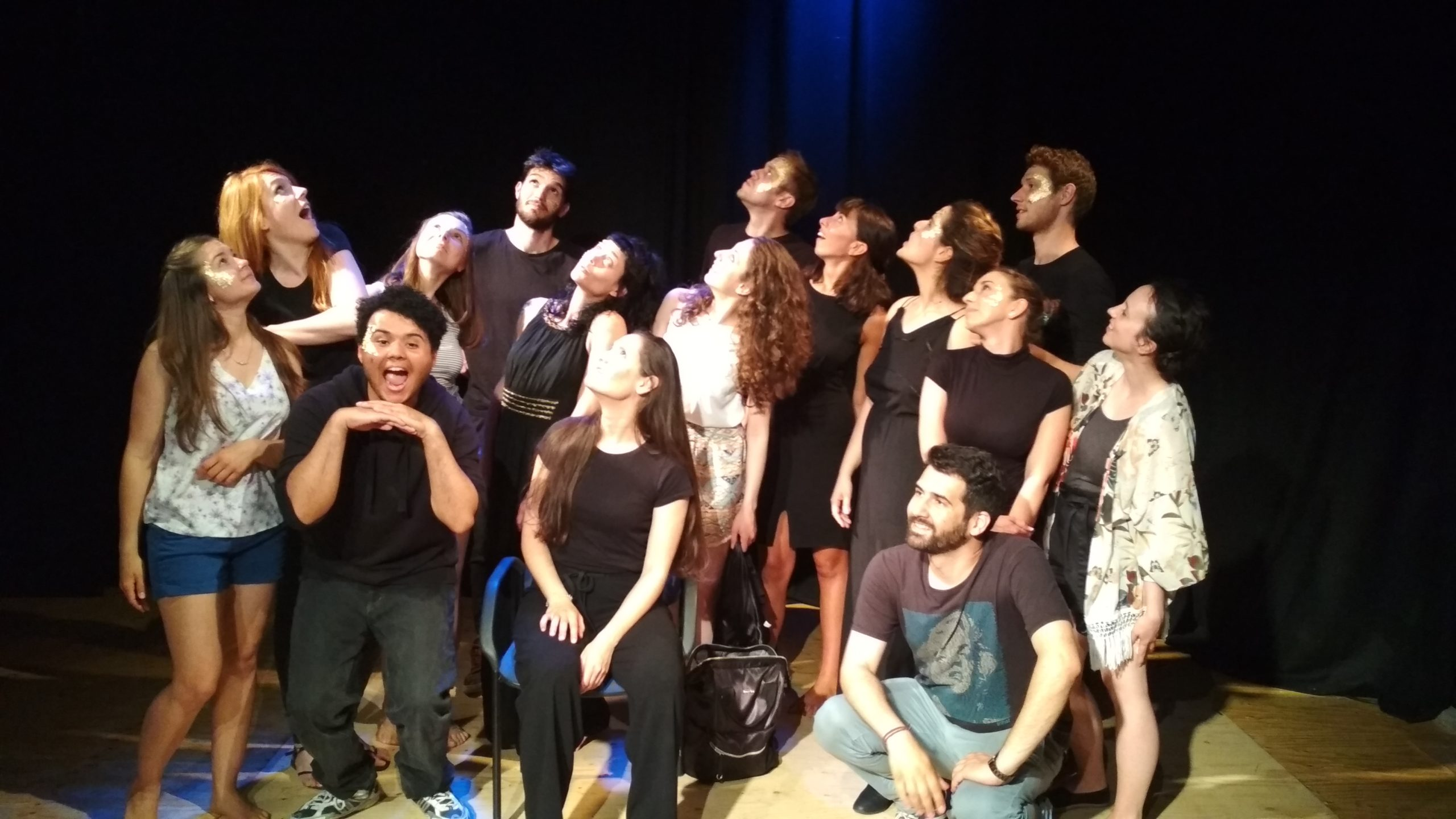 """""""Keeping up with the Greeks"""" show. Group photo of the cast and team, fifteen people. People are posing and looking up"""