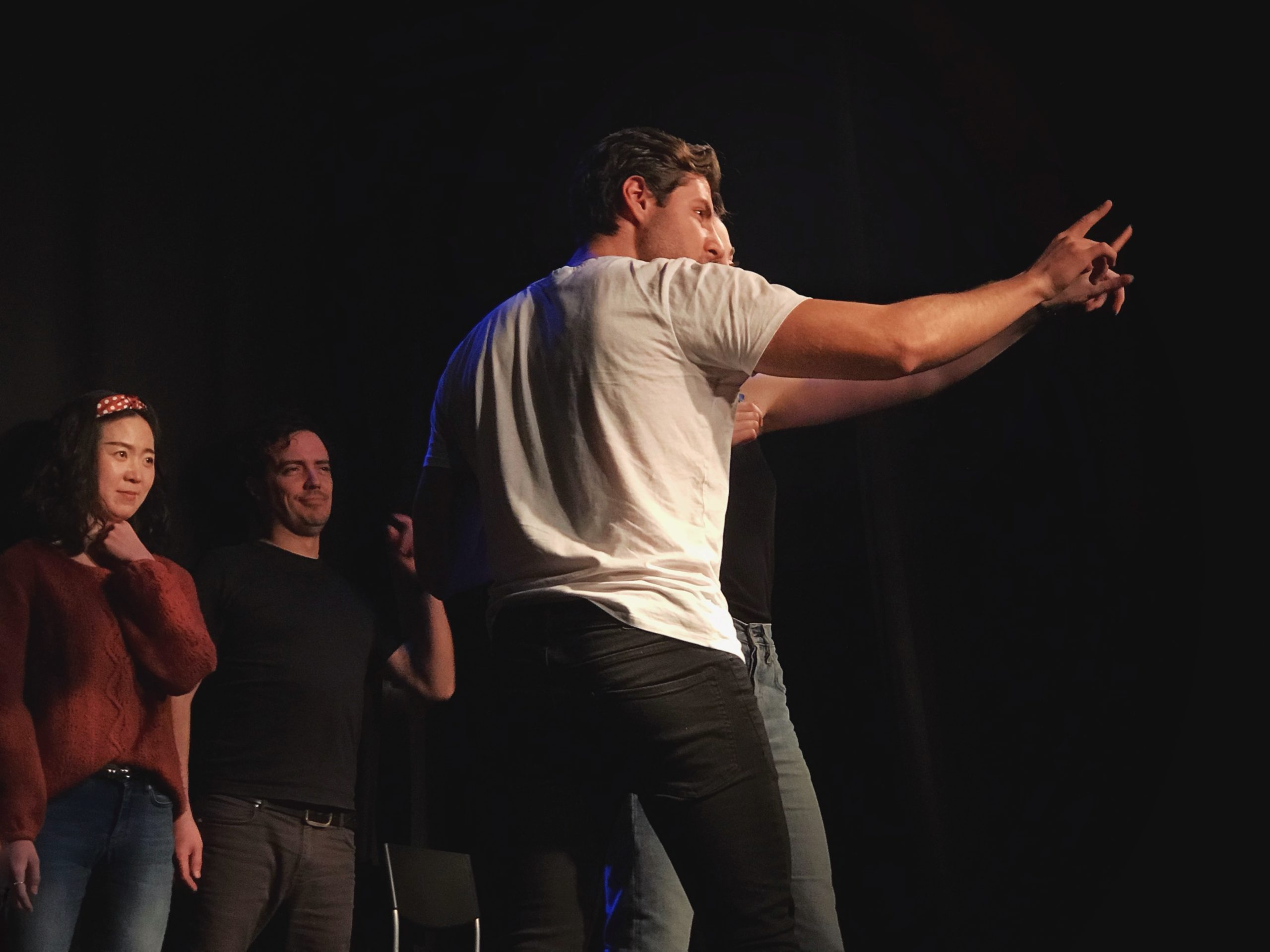 Act Attack's Pure Improv show. Two men pointing at something, while a man and a woman stand behiind them laughing disapprovingly